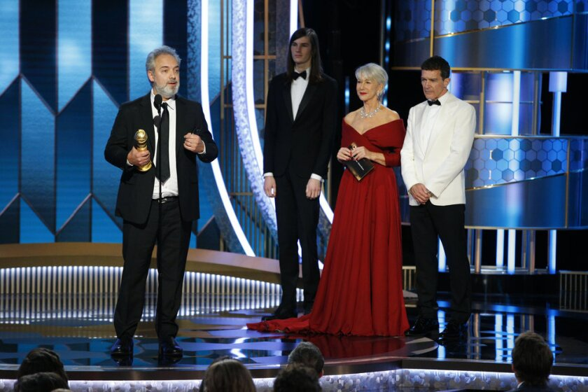 "Sam Mendes accepts the Golden Globe for film director for ""1917."""