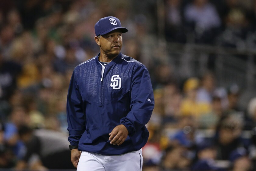 Dave Roberts, acting Padres manager for one game agianst the Oakland A's on June 15, heads to the dugout after a visit to the mound.