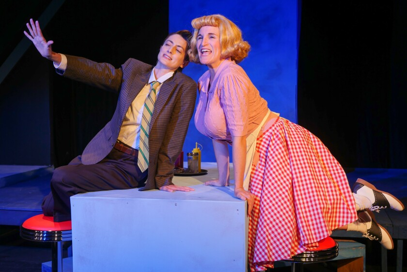 """Emily Jerez as Jim and Samantha Ginn as Myrna, one of the twins she plays in Moxie Theatre's """"The Mineola Twins."""""""