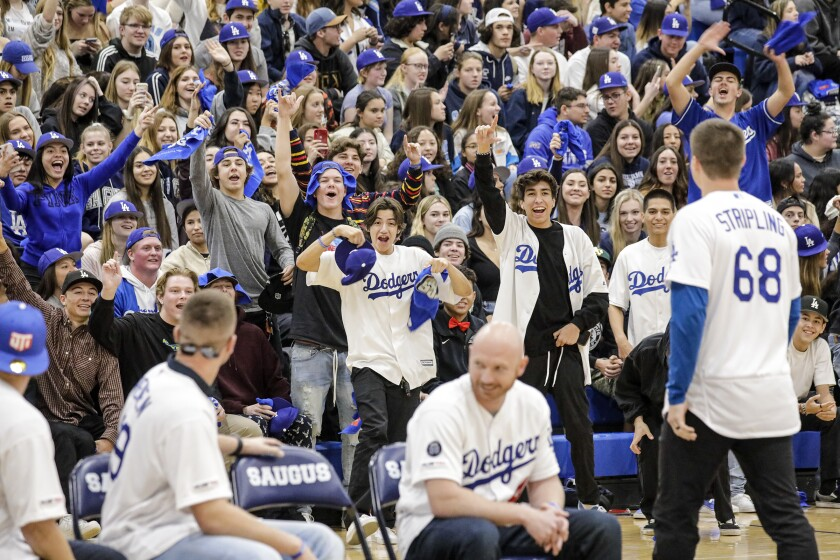 Saugus High students give a warm welcome to pitcher Ross Stripling and other Dodgers players during a pep rally at the Santa Clarita school on Friday.
