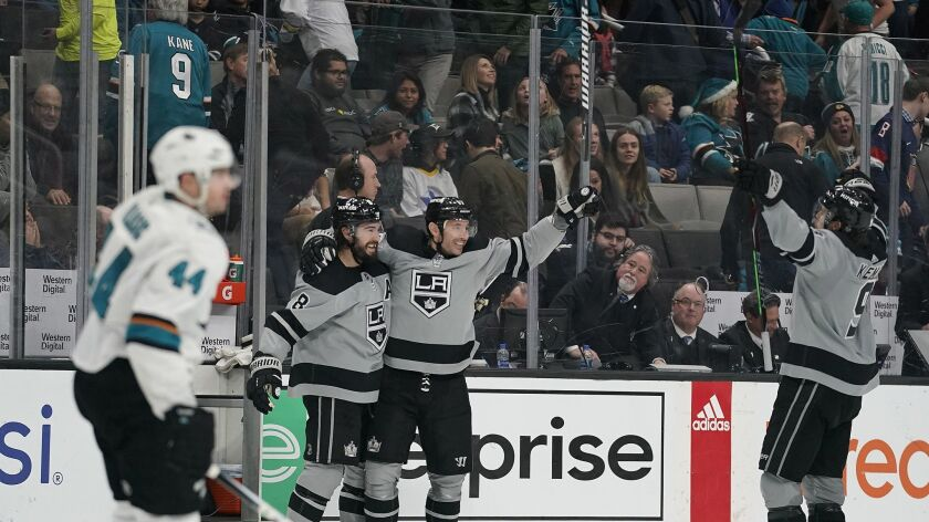 Kings left wing Ilya Kovalchuk celebrates with teammates Drew Doughty (8) and Adrian Kempe (9) after scoring against the San Jose Sharks in overtime.