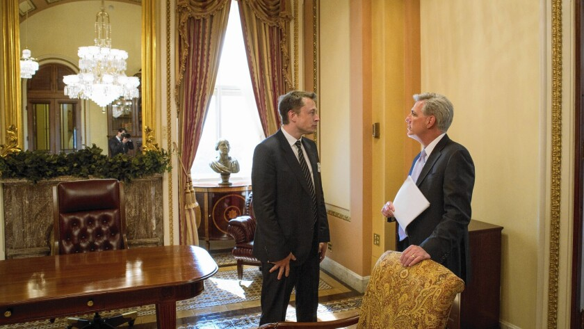 """Elon Musk, left, of Tesla and SpaceX, talks with House Majority Leader Kevin McCarthy in June. McCarthy once praised the launch of SpaceX's Falcon 9 rocket as """"a pivotal moment for the future of spaceflight."""""""