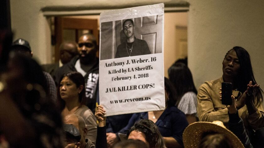 LOS ANGELES, CA - FEBRUARY 07: A sign with a photograph of slain 16-year-old Anthony Weber is held