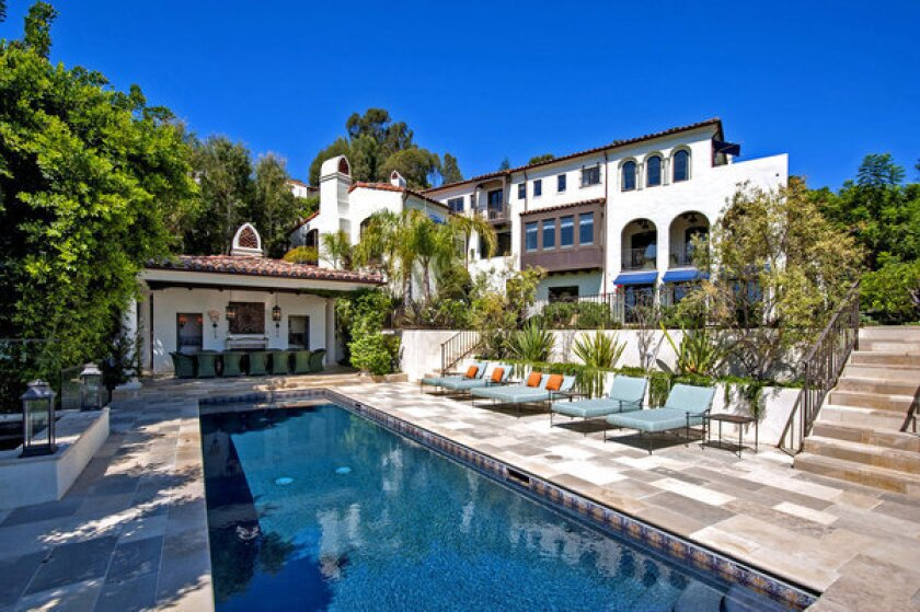 Amenities on the one-third-acre property include a swimming pool with a pool house.