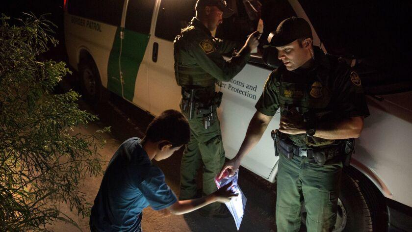 HIDALGO, TEXAS -- FRIDAY, MARCH 24, 2017: Border Patrol agents Edgar Cano, right, and Richard Schwe
