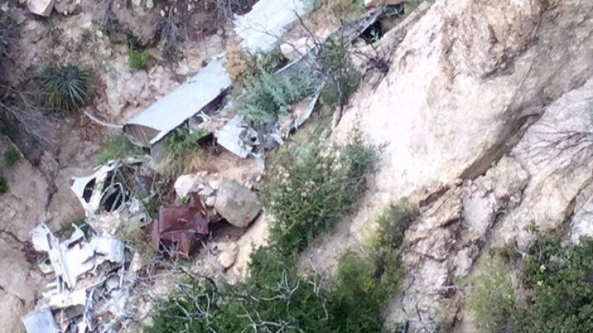 Wreckage from a plane crash is strewn on the side of Mt. Wilson. The body of the pilot was recovered Monday night, coroner's officials said.