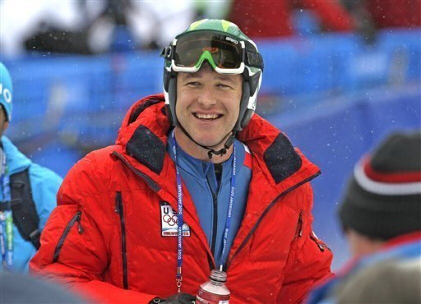 Bode Miller of the United States smiles after completing first training for the Men's Downhill at the Vancouver 2010 Olympics in Whistler, British Columbia, Wednesday, Feb. 10, 2010.   (AP Photo/Sergey Ponomarev)