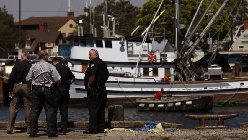 LAPD Harbor Division detectives and police officers investigate the scene of a crash in 2015 that killed two children after their family car plunged into the San Pedro harbor.