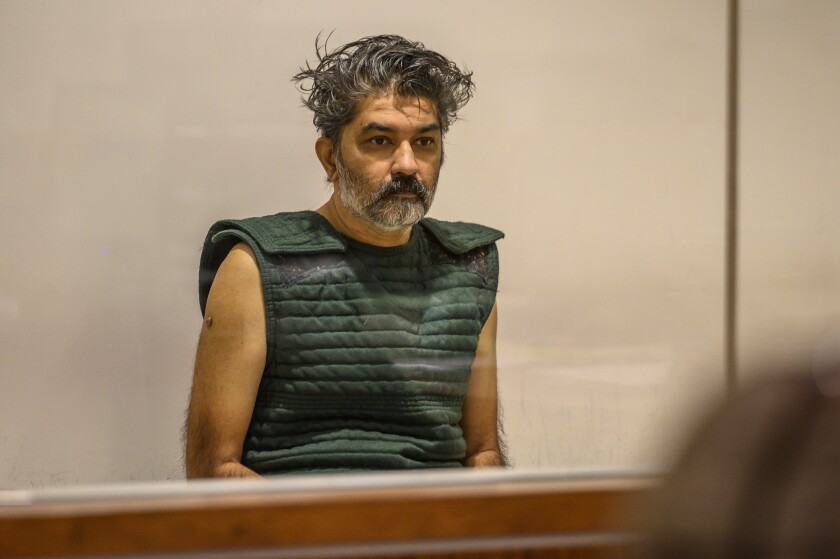Shankar Hangud, wearing a personal safety vest, appears in the Placer County Superior Court in Roseville, Calif., on Oct. 16. Officials have identified four people slain in October as the wife and three children of Hangud.