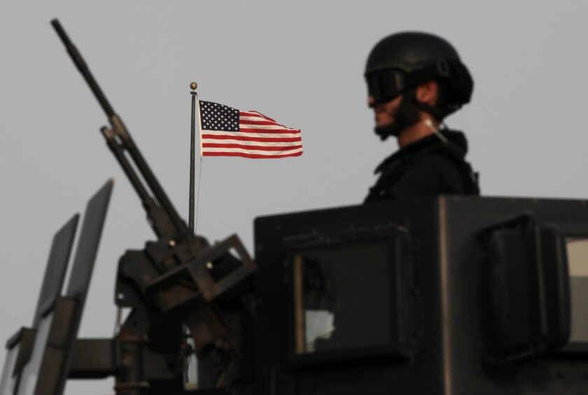 A Bahraini armored personnel vehicle reinforces U.S. Embassy security just outside a gate to the embassy building in Manama, Bahrain, on Sunday.