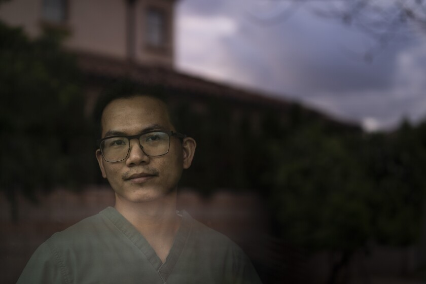 ICU nurse Meynard Villa poses for photos in his start-up senior care home in Arcadia, Calif., Thursday, March 25, 2021. Villa was on the verge of losing his family's $150,000 investment in his new senior care home because he couldn't hire workers while grappling with a glitchy state system designed to automate criminal background checks. (AP Photo/Jae C. Hong)