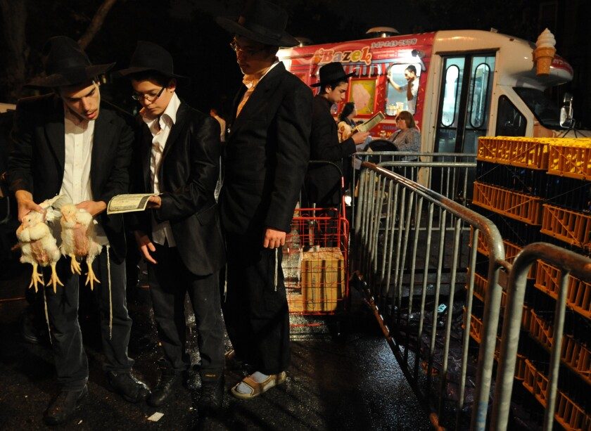 The ancient Jewish Kaporos tradition, which involves swinging and slaughtering chickens, is practiced in Crown Heights, Brooklyn.