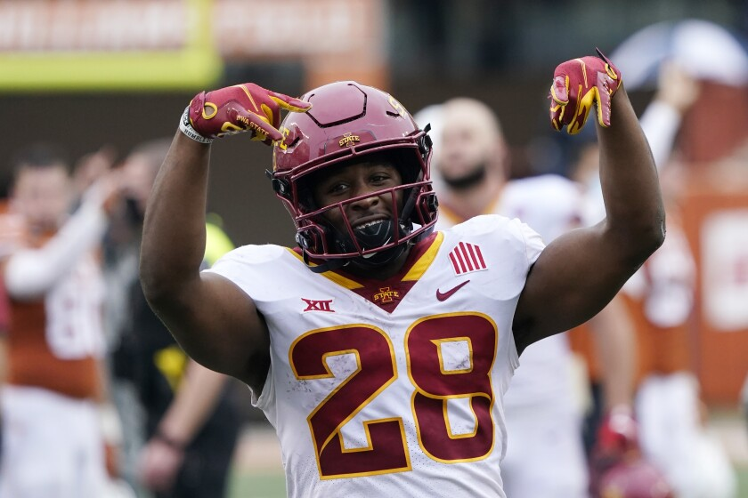 Iowa State running back Breece Hall (28) celebrates the team's win over Texas in an NCAA college football game, Friday, Nov. 27, 2020, in Austin, Texas. (AP Photo/Eric Gay)