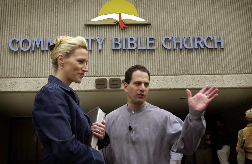 Rev. Barry Minkow and wife Lisa greeting parishioners at the Community Bible Church in Mira Mesa in 2002.