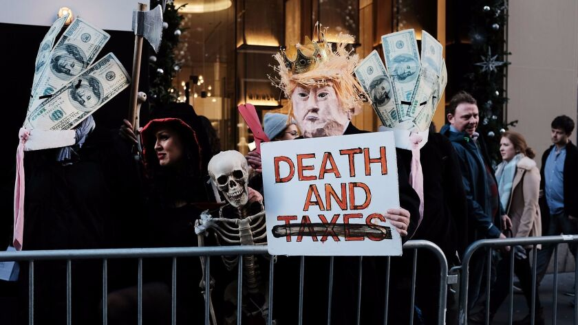 Protesters opposed to the Republican tax bill demonstrate outside Trump Tower in New York on Nov. 21.