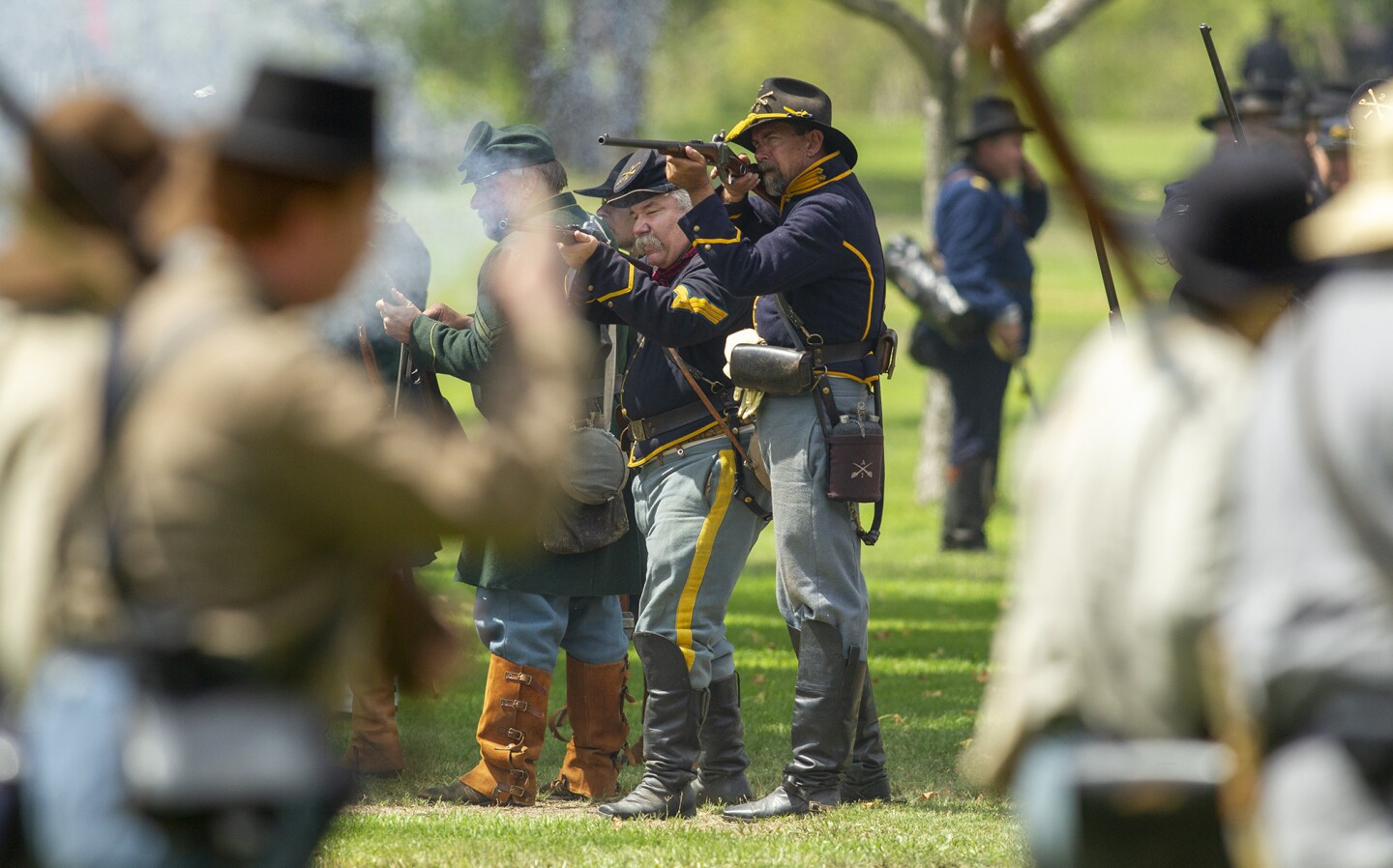 Union army soldiers fire at Confederate army soldiers during a battle at the 24th annual Civil War Days Living History Event in Huntington Beach Central Park on Saturday, September 1.