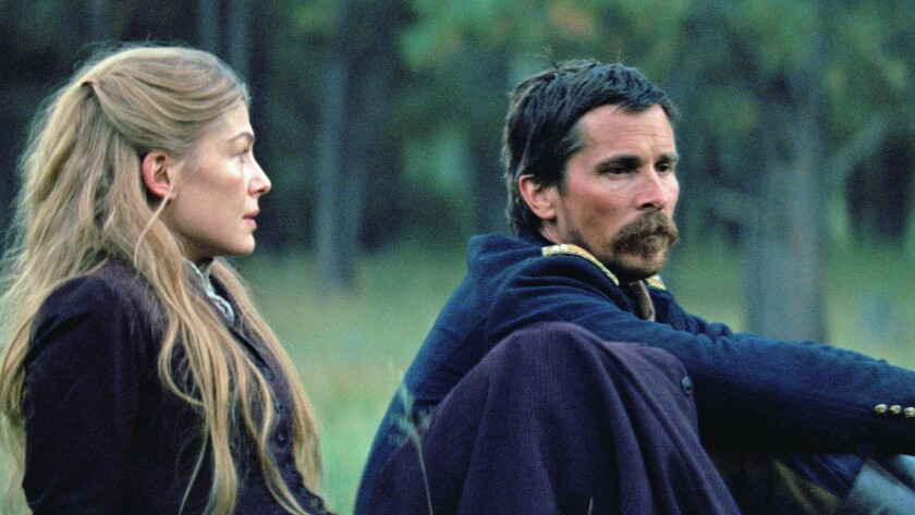 """(L-R) - Rosamund Pike and Christian Bale in a scene from the movie """"Hostiles."""" Credit: Entertainment"""