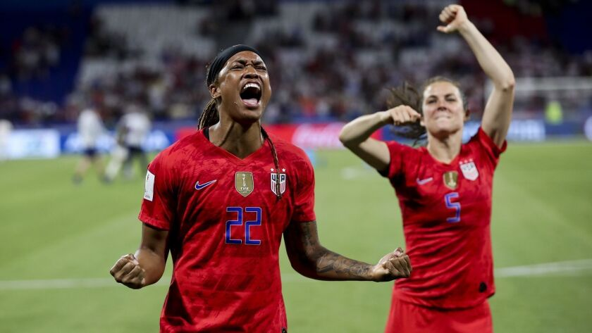United States' Jessica Mcdonald, left, and Kelley O Hara celebrate after winning the Women's World C