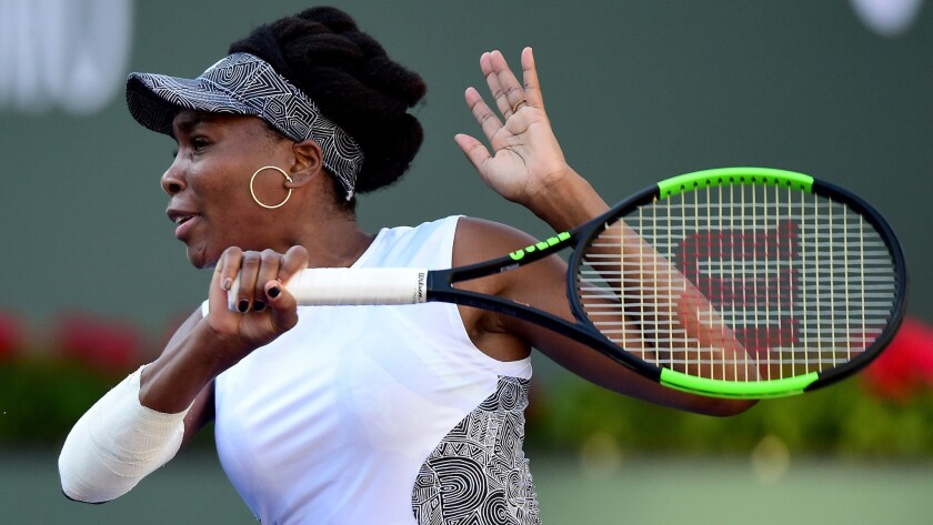 Venus Williams follows through on a forehand during her match Saturday at the BNP Paribas Open.