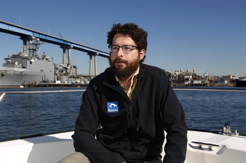 Travis Pritchard, interim executive director of San Diego Coastkeeper, on San Diego Bay in the group's boat, Clean Sweep. / Photo by John Gibbins * U-T
