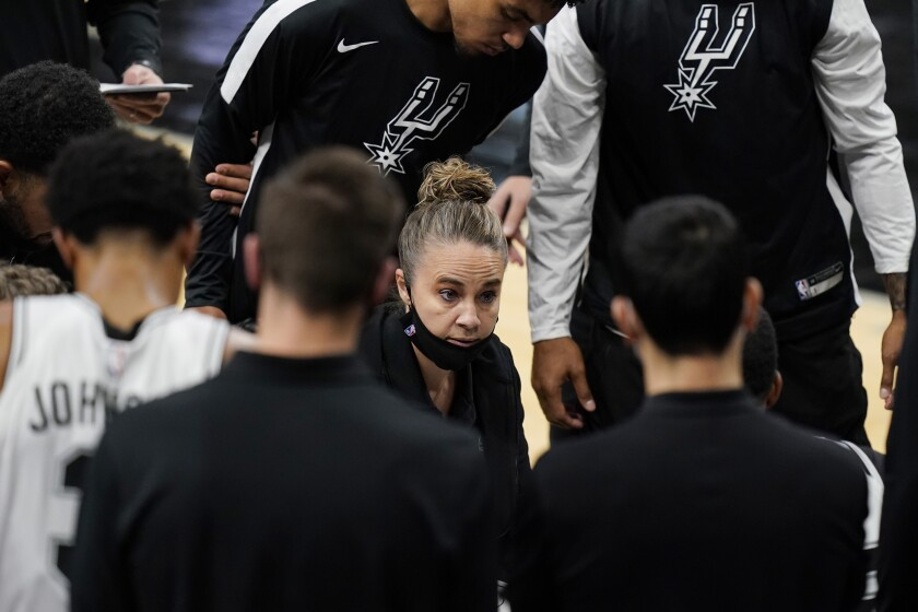 San Antonio Spurs assistant coach Becky Hammon, acting as head coach, calls a play during a timeout against the Lakers.