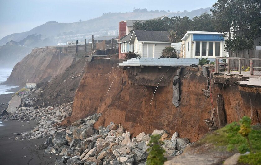 Coastal bluffs collapsed underneath homes in Pacifica during storms in 2016.