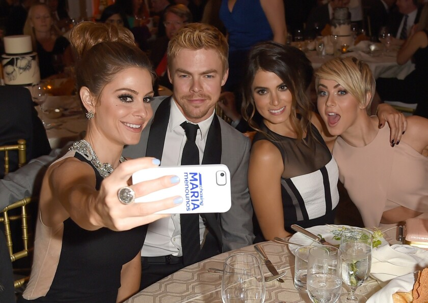 "Actress Nikki Reed, second from right, and ""Dancing With the Stars"" pro Derek Hough, second from left, have reportedly been seeing each other. Here, the pair attends the Kaleidoscope Ball with Maria Menounos, left, and Hough's sister, Julianne Hough."