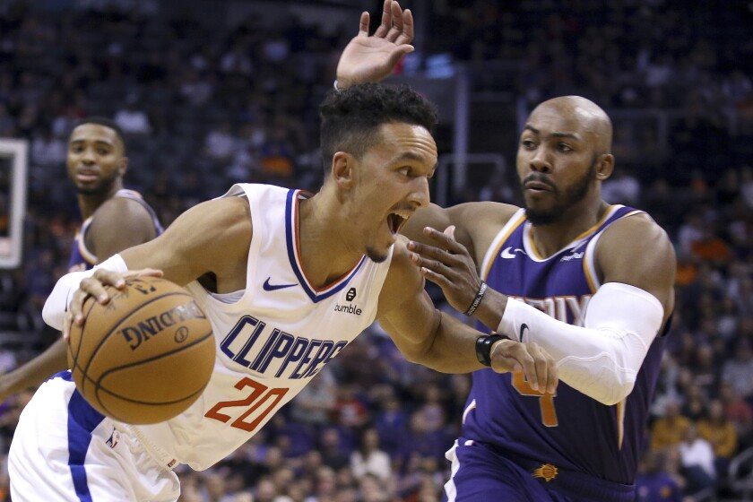 Clippers guard Landry Shamet drives past Suns guard Jevon Carter during their game Oct. 26, 2019, in Phoenix.
