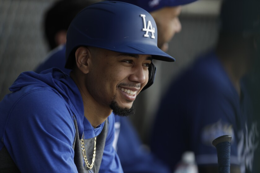 Dodgers right fielder Mookie Betts smiles during spring training Feb. 21