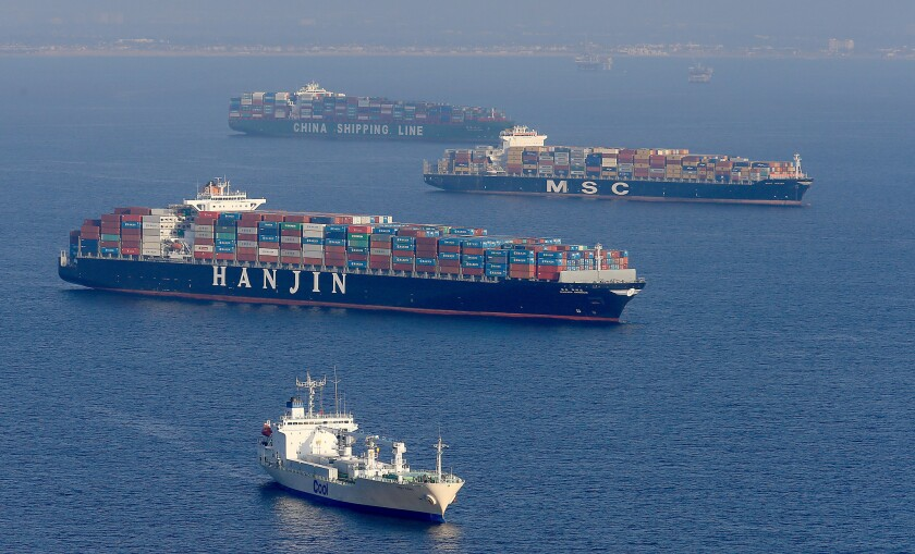 Cargo ships anchor off the ports of Los Angeles and Long Beach to await unloading on Feb. 16.