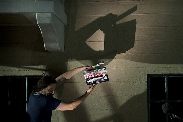 """The clapper's shadow is cast as a scene begins on the set of """"The Roommate,"""" a thriller starring Leighton Meester, Minka Kelly and Cam Gigandet."""