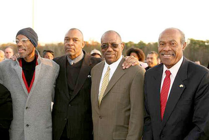 When Richard Stockton College honored G. Larry James, left, for four decades of excellence on Dec. 1, 2007, (from second left) Vince Matthews, Ron Freeman and Lee Evans joined their fellow Olympian for the festivities.