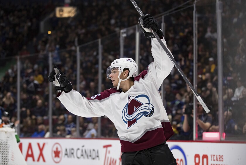 Colorado Avalanche's Andre Burakovsky, of Austria, celebrates his goal against the Vancouver Canucks during the third period of an NHL hockey game Saturday, Nov. 16, 2019, in Vancouver, British Columbia. (Darryl Dyck/The Canadian Press via AP)