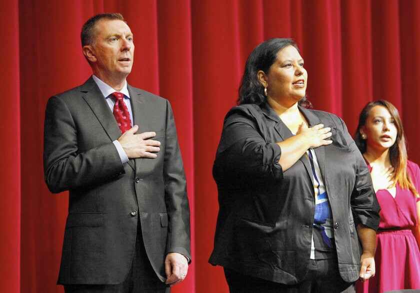 Then-Supt. John Deasy gives the Pledge of Allegiance with L.A. school board member Monica Garcia at a meeting at Garfield High School in August.