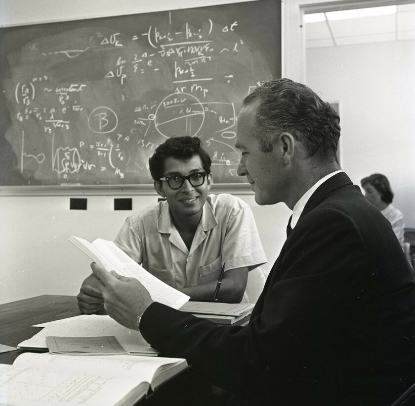 Dilip Bhadra (left) chats with professor Keith Brueckner in 1960, when the first graduate students enrolled at UCSD. U-T