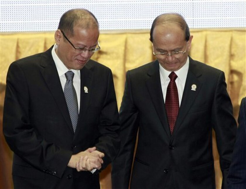 Philippines' President Benigno Aquino III, left, talks with Myanmar President Thein Sein after a group photograph at the opening ceremony of the 20th ASEAN Summit in Phnom Penh, Cambodia Tuesday, April 3, 2012. (AP Photo/Apichart Weerawong)