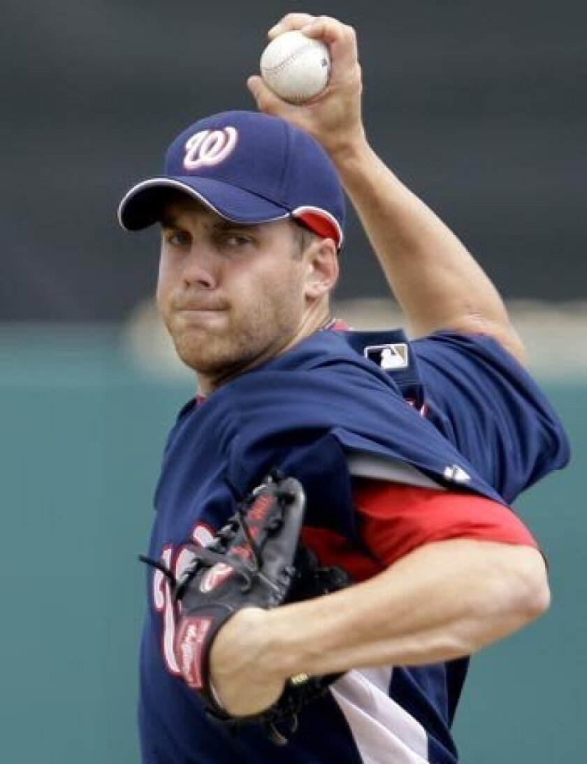 Starting pitcher Shawn Hill was picked up by the Padres after being released by the Washington Nationals last week. His fastball has been recorded in the low-90s, but his career has been plagued by injuries to this point. (AP Photo/Richard Drew)