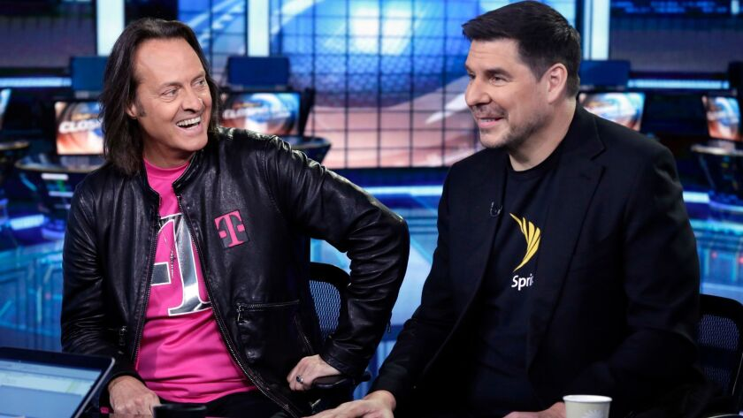 T-Mobile CEO John Legere, left, and Sprint Executive Chairman Marcelo Claure.