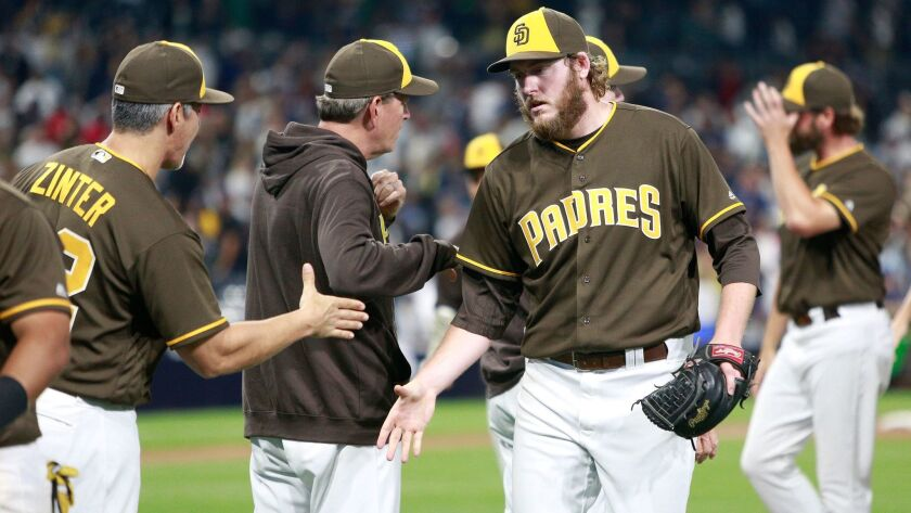 Padres relief pitcher Brandon Maurer celebrates with his teammates after closing out the Padres' 7-6 victory over the New York Yankees on Friday night, July 1, 2016, at Petco Park.
