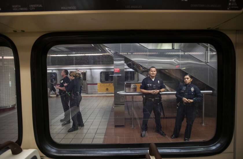 Los Angeles Police Department officers stand guard at a downtown subway station in March.