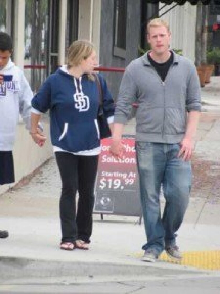 On June 18 this Verizon Wireless sign on Pearl Street was placed in the middle of the sidewalk. This couple had to separate to talk around it.