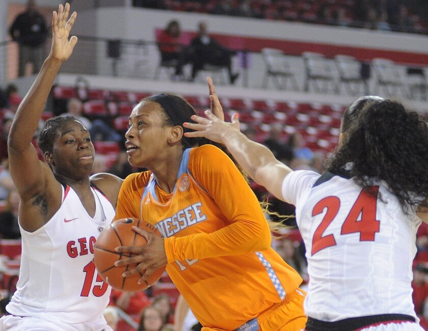 Tennessee forward Bashaara Graves, center, is pressured by Georgia forward Krista Donald (15) and Georgia guard Marjorie Butler (24) during the first half of an NCAA college basketball game Thursday, Feb. 26, 2015, in Athens, Ga. (AP Photo/Richard Hamm)