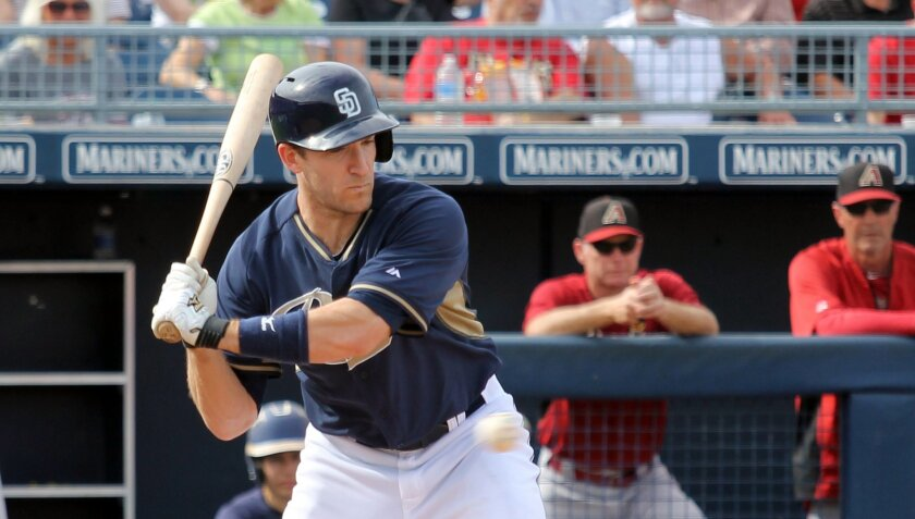 Padres outfielder Chris Denorfia looks at a pitch against the D-backs in a spring training game at Peoria, Ariz.