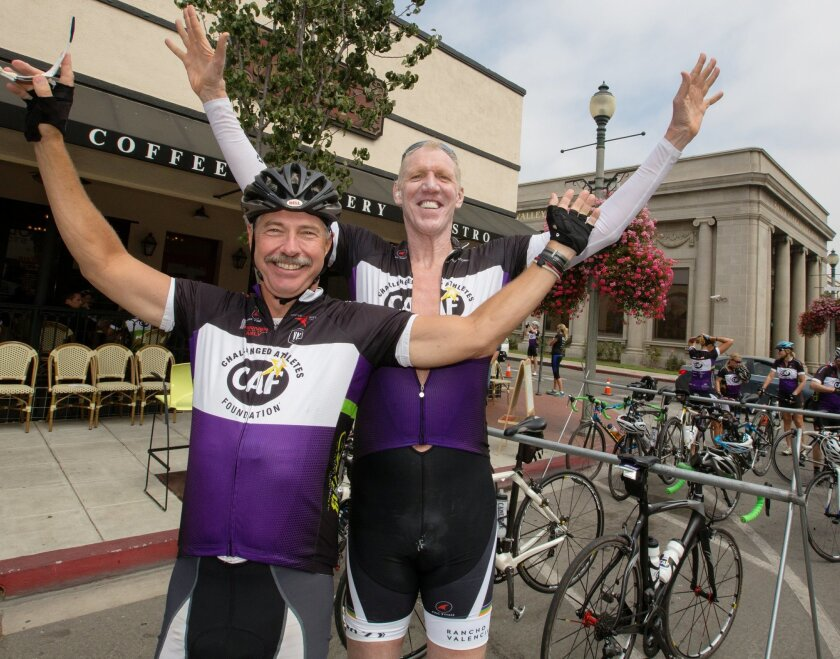 Bill Geppert, left, rejoices with Bill Walton after they finish a bike ride together. Geppert, a board member of the Challenged Athletes Foundation, is taking over as interim CEO of the group until a permanent CEO is hired.