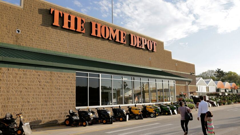 FILE - In this May 18, 2016, file photo, people approach an entrance to a Home Depot store in Bellin