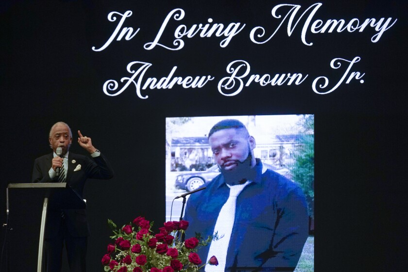 """FILE - In this May 3, 2021, file photo Rev. Al Sharpton speaks during the funeral for Andrew Brown Jr., at Fountain of Life Church in Elizabeth City, N.C. Brown, the unarmed Black man who was fatally shot in April by sheriff's deputies in North Carolina, died from a """"penetrating gunshot wound of the head,"""" according to the official autopsy results released Thursday June 10. (AP Photo/Gerry Broome, File)"""