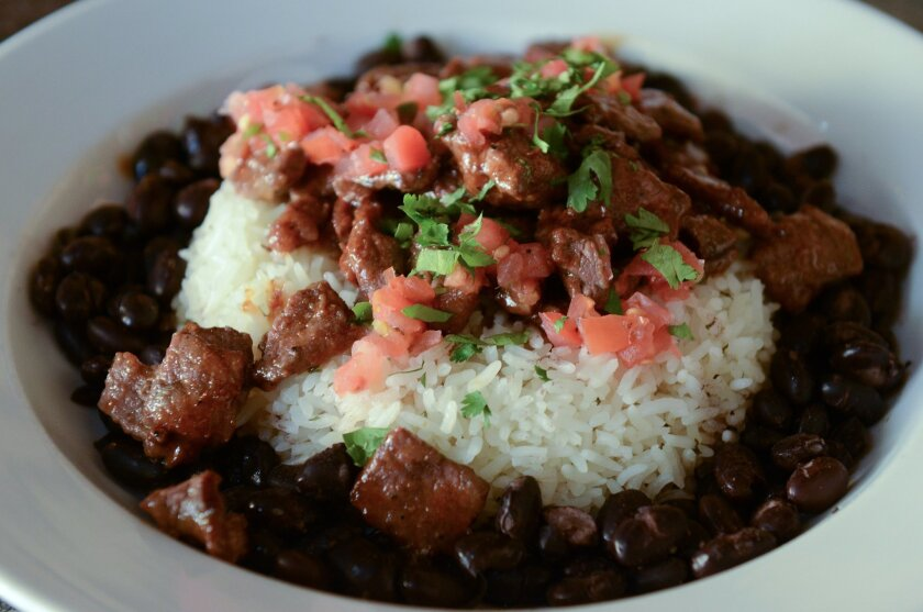 The Maui Bowl at Wahoo's Fish Taco features teriyaki-marinated Angus steak and salsa fresca with a choice of steamed white-or-brown rice and black-or-white beans.