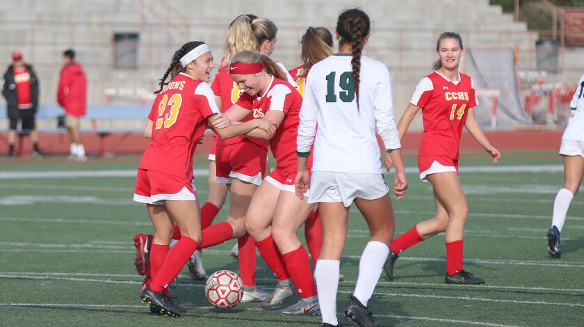 Cathedral junior Caylee Hornaday (23) is greeted by teammates after scoring Thursday's first goal.