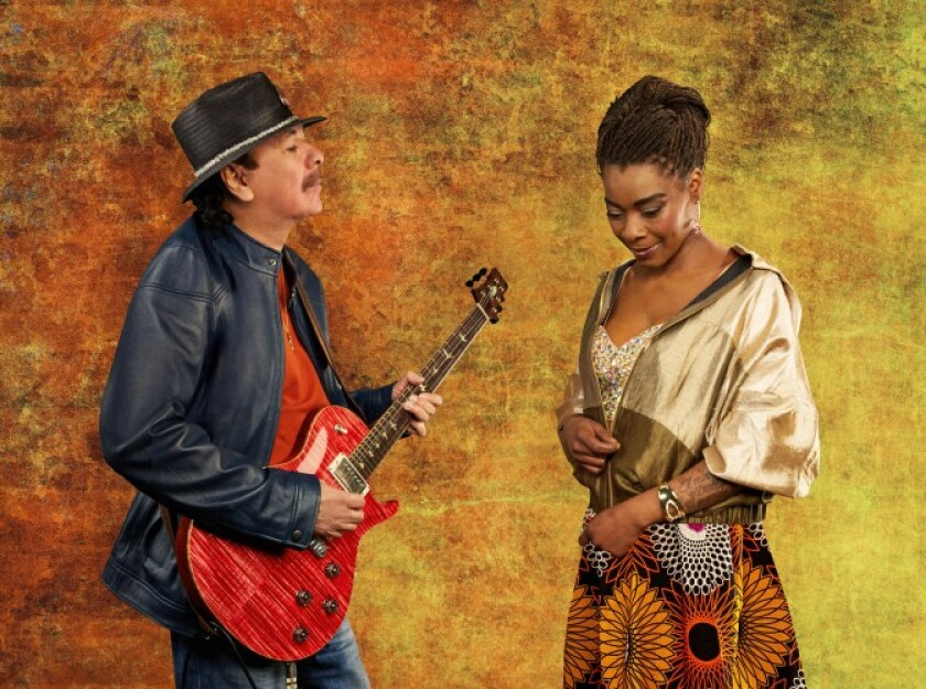 Carlos Santana is shown with Spanish-African vocal star Buika
