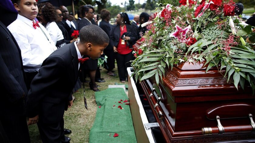 LOS ANGELES, ME- Feb. 7, 2015- Family members look over the coffin of Terry Carter, 55, -who was s